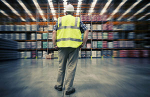Manufacturer staring at warehouse inventory