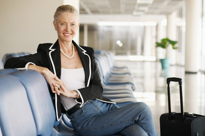 Lady sitting in an airport terminal