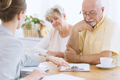 Elderly couple filling out paperwork