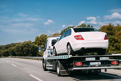 Car being towed away or repossessed.